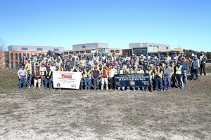 The men and women of IBEW 1253 in front of Maine General Medical Center.  Contractor: E.S. Boulos, Photo: Dean Denis